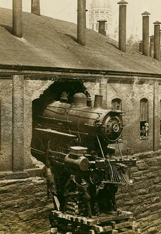 Locomotive No.321 crash through roundhouse