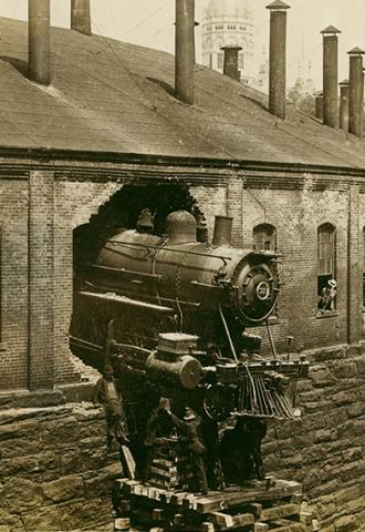 Locomotive No.321 crash through roundhouse